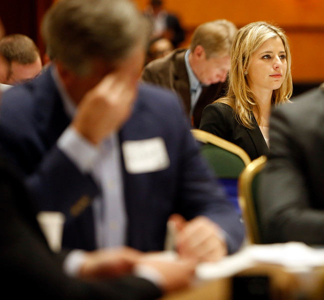 Caitlin Boewe listens to Lawrence Yun, Chief Economist and Senior Vice President of Research at the National Association of Realtors, gives his presentation at the 2015 Greater Tulsa Commercial Market Update seminar.