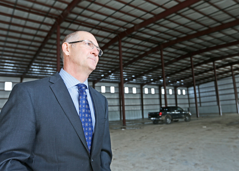 MidAmerica Industrial Parks David R. Stewart, chief administrative officer inspects a spec built building being constructed at the park.
