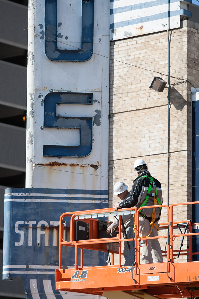 A crew from  with Walter P Moore Engineers and Consultants inspect the sign of the Union Bus Station in downtown Oklahoma City.