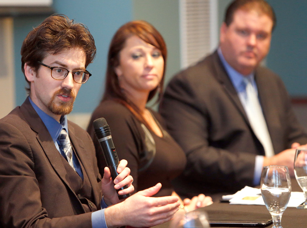 During the Owasso Economic Summit Warren Unsicker, Angela McLaughlin and Matt Hamrick answer audience question during a panel discussion on downtown development.