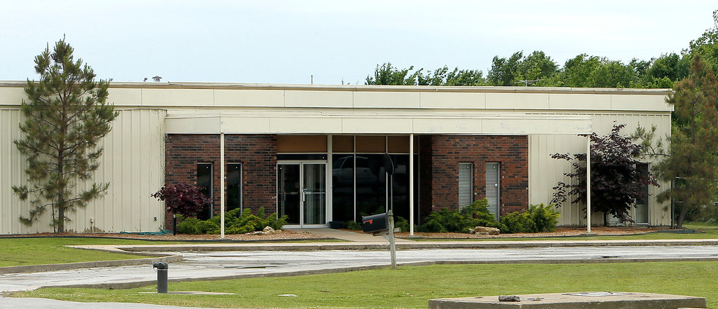 Storage tank manufacturer Containment Solutions has entered Oklahoma with its $4.09 million purchase of a 37-year-old Tulsa industrial building. Tulsa County Courthouse records indicate Conroe, Texas-based Containment Solutions Inc. paid $27.78 per square foot to seller Pecofacet (Oklahoma) LLC for the 10-acre property at 9910 E. 56th St. North. Containment Solutions builds fiberglass tanks for storing water, petroleum products, and other liquids. Officials with the 51-year-old private company would not comment on the 147,479-square-foot Tulsa building. CBRE industrial broker David Glasgow, who handled the sale with an Ohio counterpart, said the site remains in good condition for its age. The 1978-vintage structure offers 30-foot ceiling heights, a pair of 3-ton cranes, and one 7.5-ton crane. Pecofacet, based in Mineral Wells, Texas, operates a technology center in the Tulsa building. Glasgow said it expects to vacate the site later this year. <br /> – Kirby Lee Davis