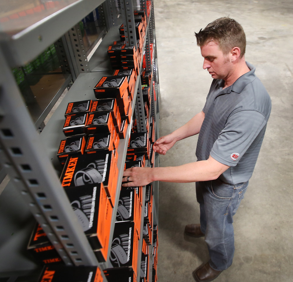 Aaron Henson, Account Manager for BDI, pulls stock for an order at the companies Tulsa location.