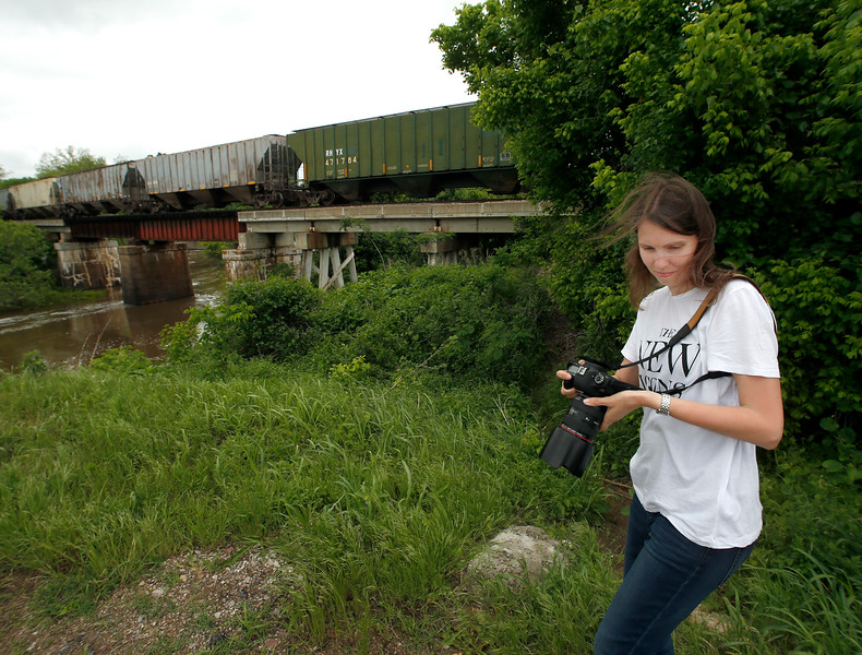 Ellen Klinkel photographs the 1921 Ozark Trail Rt66 bridge West of Sand Springs.  Ellen and her husband Udo are from Germany are one week into a a four week vacation cruising the length of Rt66.