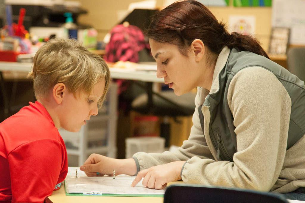 Gabriela Escobar works with autistic student Riley Driscoll at Good Shepard School in Oklahoma City, OK.
