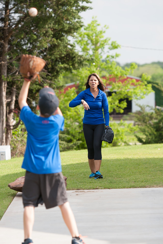 Traci Brown plays catch with her sons at their home in Stillwater, OK.