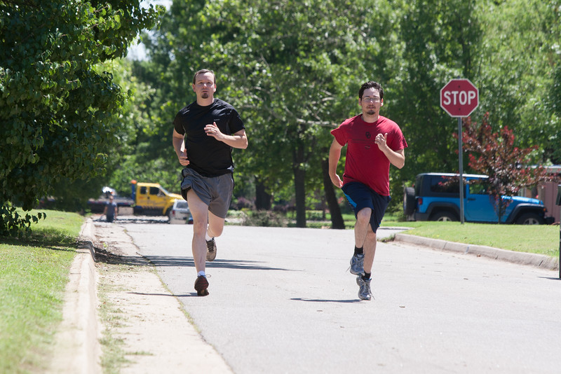 OWRB employees Derrick Wagner and Jacob Hernandez run during their lunch hour in the neihborhood behind their work.