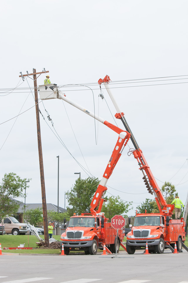 OG&E crews working to restore power after a tornado damaged power lines on Tecumseh Road in Norman, OK.