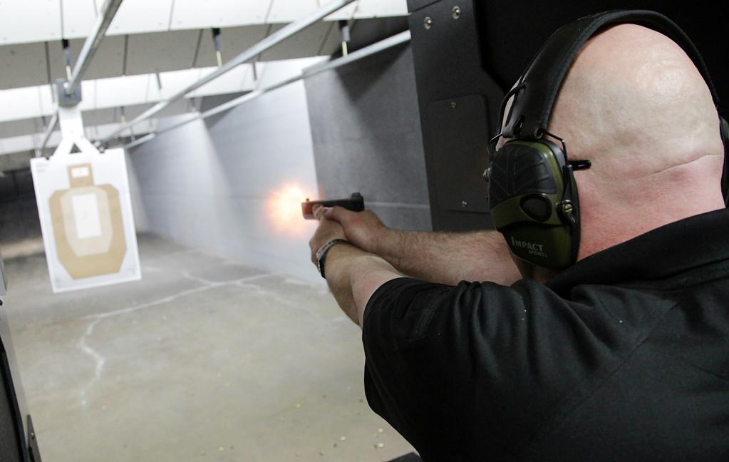 Blue Buchanan in the gun range at Wilshire Gun at 615 W Wilshire in Oklahoma City.