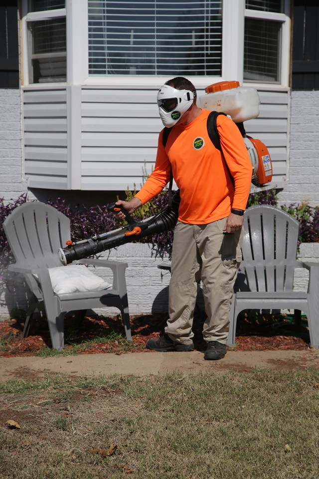 Rich Anothony, owner of Mosquito Joes, spraying a home in Edmond, OK.