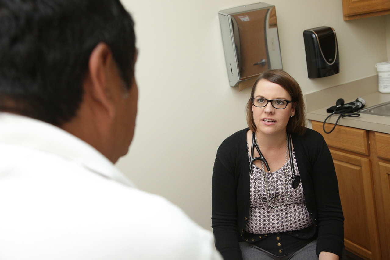 Audra Ball, PA-C talking to a patient at Good Sheperds Minisries located at 222 NW 12th Street in Oklahoma City.
