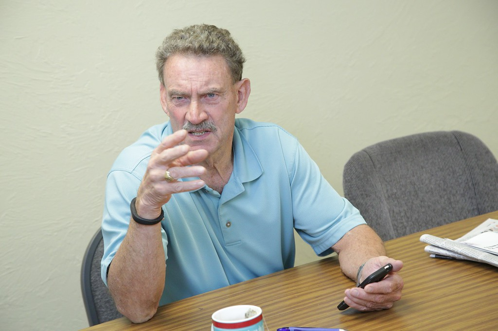 George Crooks, executive director of the Depression and Bipolar Support Alliance of Oklahoma, gestures while discussing mental health policy.