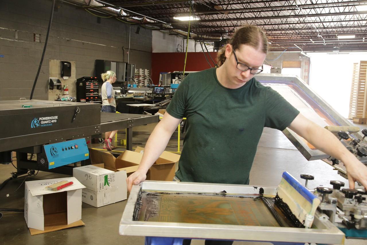 Jeren Martin printing t-shirts at Oklahoma Shirt Company at 26 NE 10th in Oklahoma City.