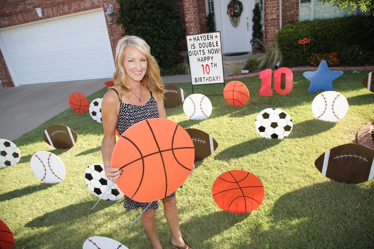 Any Goidman, owner of Signs 2 Celabrate, installing signs for a birthday party at a home in Oklahoma City, OK.