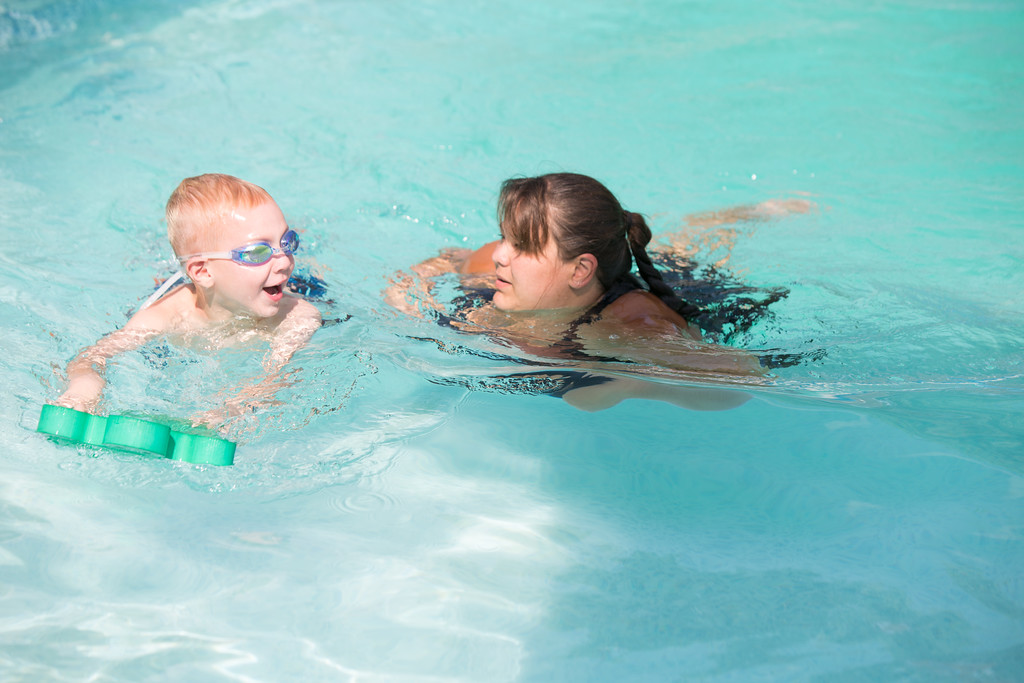 Brandy Tibbs, owner of Swim for Life, giving private swim lessons at a home in north west Oklahoma City.