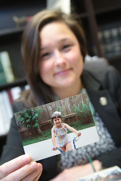 Oklahoma State Repersenitive Cyndi Munson holding a photo of herself as a child.