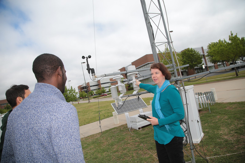 Renee McPherson with students at a MESONET station located just east of the National Weather Center in Norman, OK.