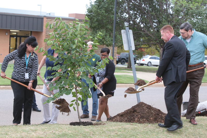 The Oklahma State Labor Commision planted a redbud tree in honor of former Commisioner Mark Costello on the one year anniversery of his death.