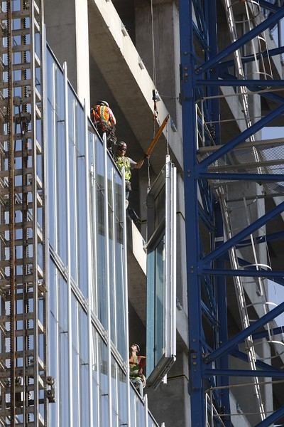 A glass panel being installed on the new Bank of Oklahoma building in downtown Oklahoma City.