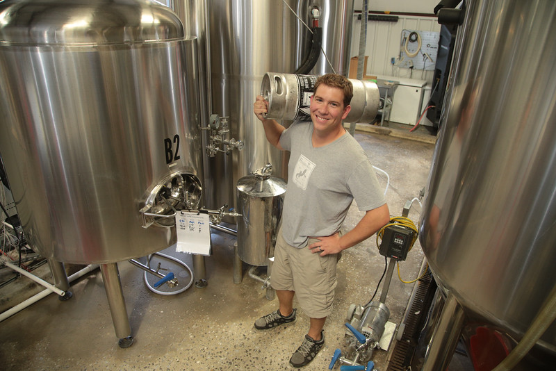 Blaine Stansel, owner of Roughtail Brewery, prepares kegs for Exchange on Film Row in Oklahoma City.