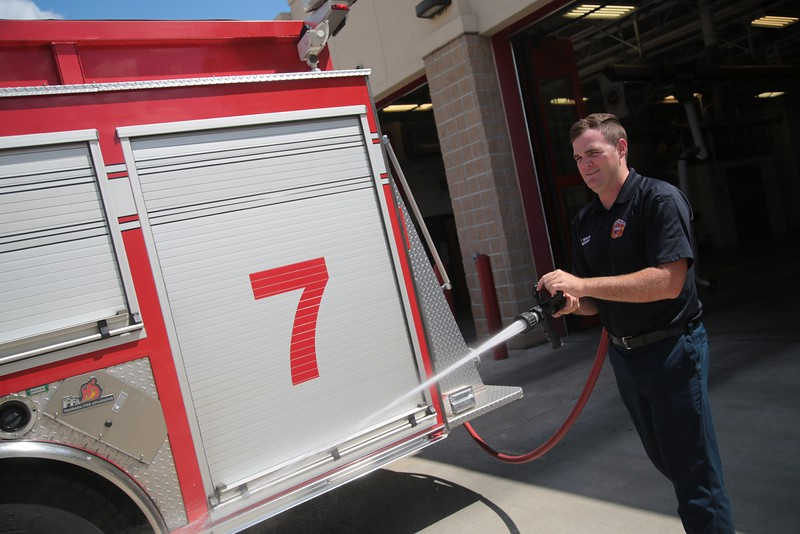 Tyler Wilmoth test a the pumps on a firetruck ar Fire Station 7 in Oklahoma City.