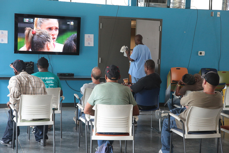 People at the Homeless Alliance day shelter in Oklahoma City watching the Olympic Games.