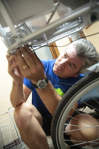 John Quigly prepares one of the new Spokies bicycles being deployed in Oklahoma City, OK.