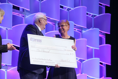 Mary Foxworth (right), with Tulsa Technology Center, was awarded a ten thousand dollar check by Express Personel CEO Bob Funk at this year's Oklahoma CareerTecConferance in Oklahoma City.