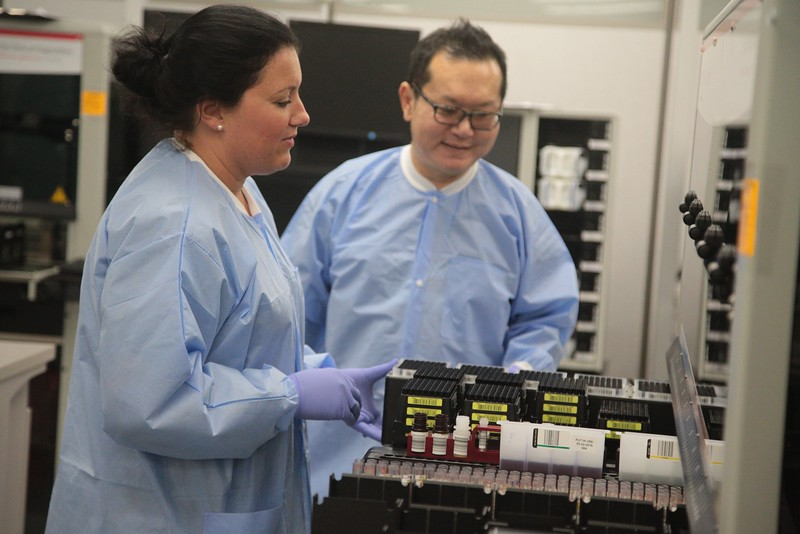 Jamie Gerrard and Michael Ling prepare blood samples for testing at Oklahoma Blood Institute in Oklahoma City.