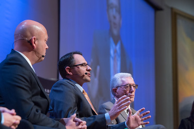 Dr. Russell Evans (center), executive director of the Steven C. Agee Economic Research & Policy Institute at Oklahoma City University's Meinders School of Business at the Greater Oklahoma City Chamber of Commerce State of the Economy luncheon.