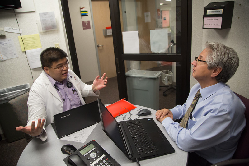 Resident Dr. Frank Wu consults with attending physician Dr. Robert Salinas at OU Physician's Family Medicine located at 900 NE 10th Street in Oklahoma City, OK.