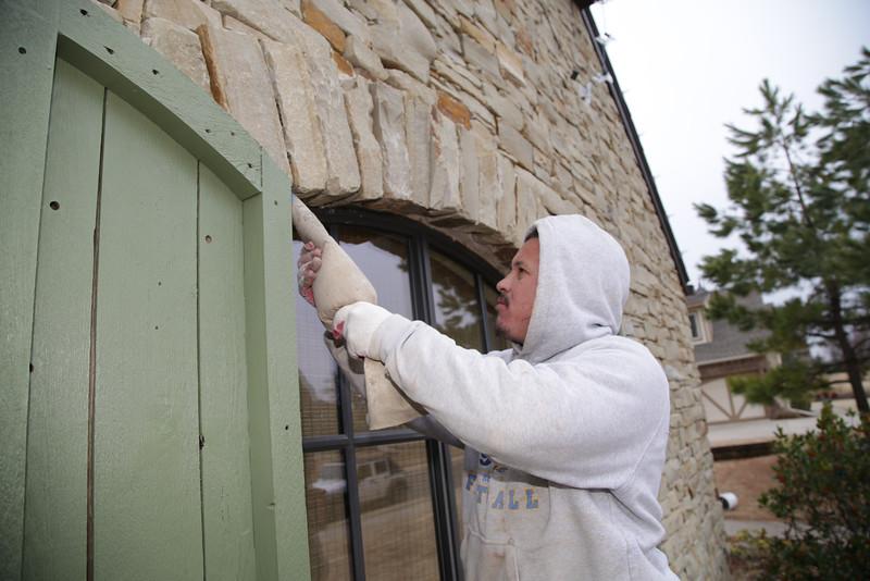 Sergio Macias works repairng a home that suffered earthquake damage in the Fairfax Niehborhood in Edmond , OK.