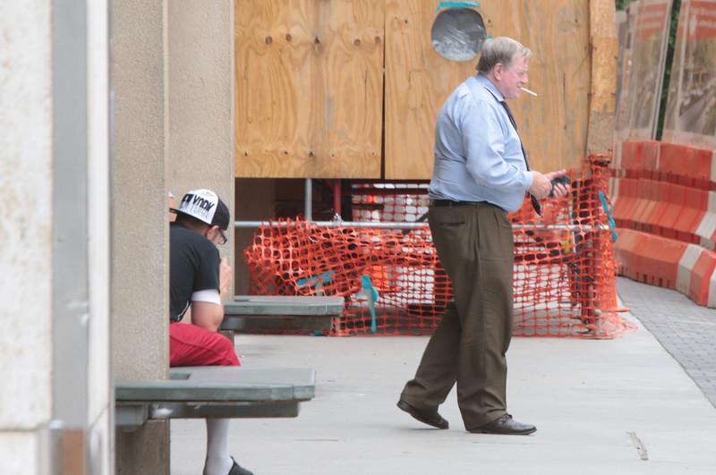 Two men smoking outside the Oklahoma Count Courthouse in Oklahoma City, OK.