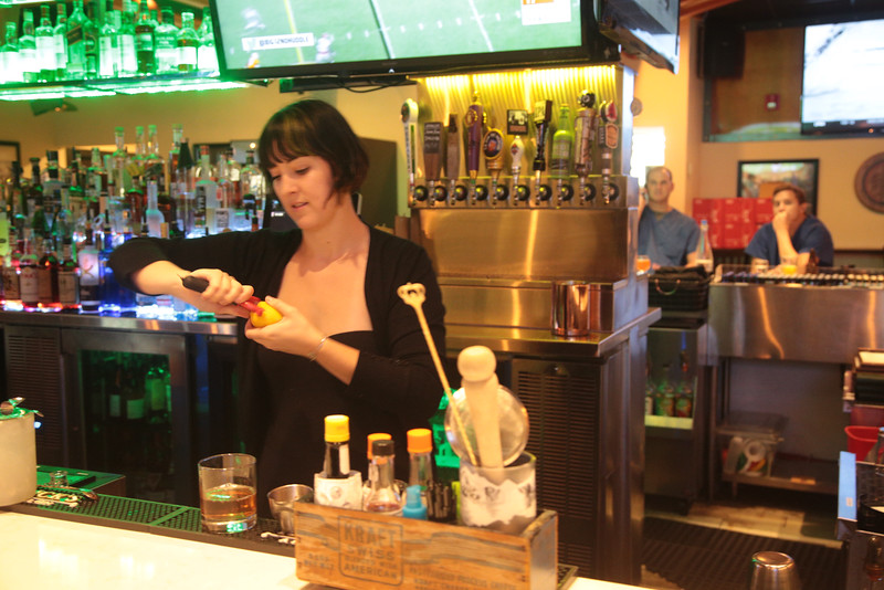 Rachel Custer mixes a drink at Pub W located at 3121 W Memorial in Oklahoma City, OK.