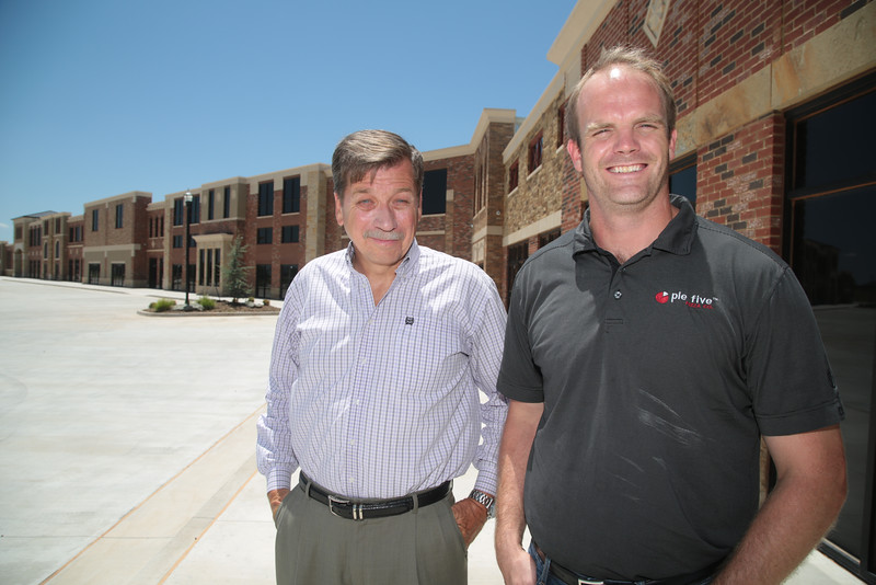 John Nail, owner of Yhe Plaza at Stone Mill in Yukon, with his first tenent Billy Bagema, franchise owner of Pie Five Pizza.
