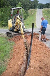 Citizen Pottawatomie Nation lays a new water pipe along Coker Road north of I-40 in Pottawatomie County.