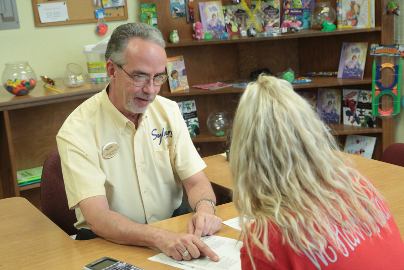 Blain Moore helps a student at Sylvan Learning Center at 8816 S Pennsylvania in Oklahoma City, OK.