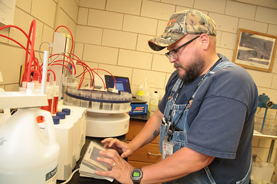 Clayton Herron testing water at the Norman Water Treatment Plant at 3000 E Robinson in Norman, OK.