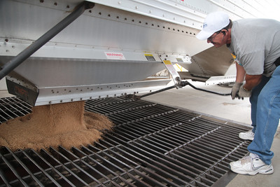 Jerry Yancey unloads wheat grain for processing at Shawnee Mill in Shawnee, OK.