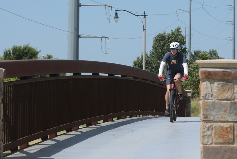 A man riding his bike along the Oklahoma River in Oklahoma City, OK.