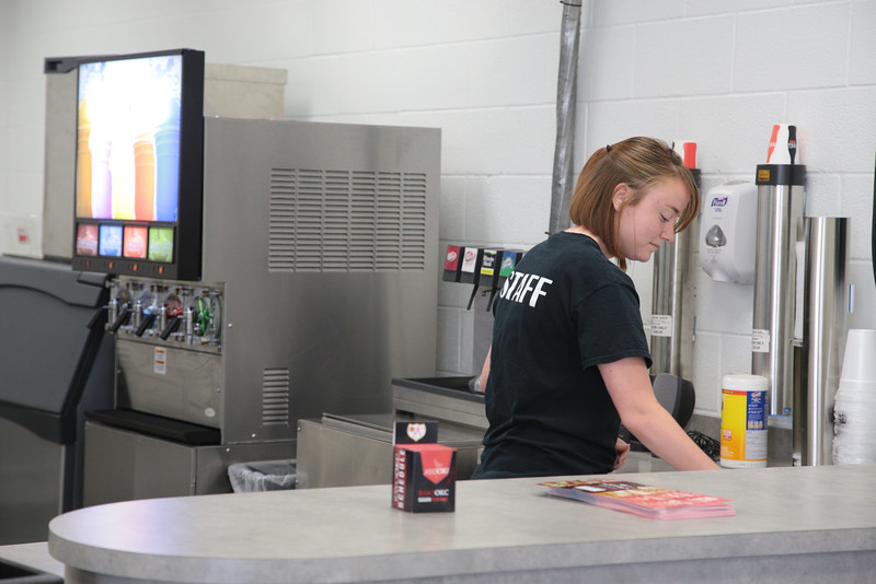 Manager Samatha Cook cleaning the concession counter at OKC Sports Center located at 11100 N Kelkey in Oklahoma City, OK.