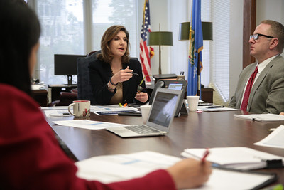 State Superintendent Joy Hofmeister holds a meeting in her office to discuss cuts to the state's education budget.