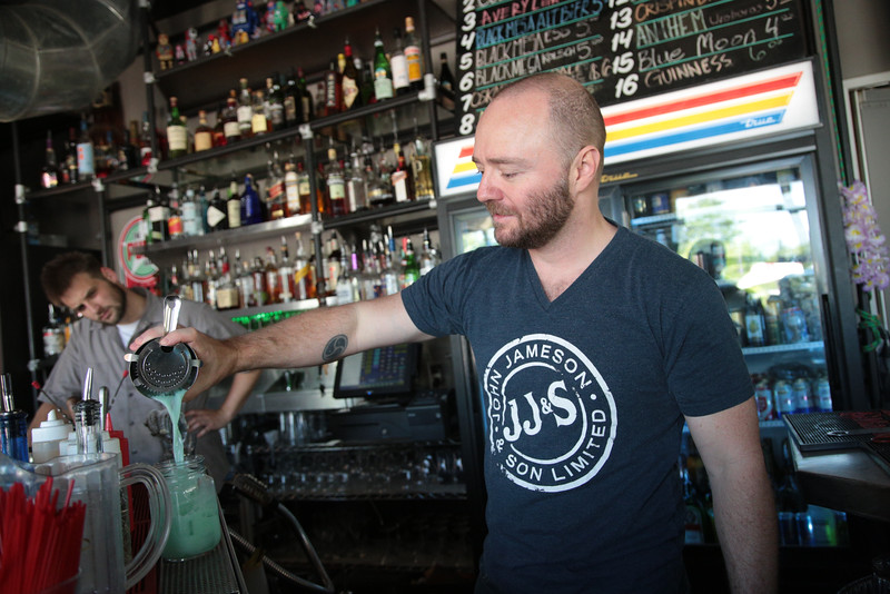 Jake Cross makes a mixed drink at The Pump Bar located at 2425 N Walker Ave in Oklahoma City, OK.