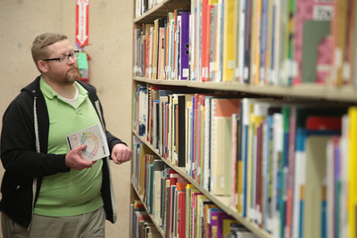 Douglas Amos reshelves books at the Oklahoma Department of Libraries in Oklahoma City.