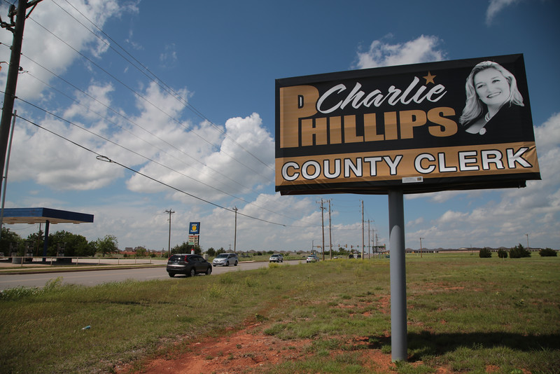 A campaign billboard at N. May Ave and NW 150th Street for canidate Charlie Phillips who is running for Oklahoma Count Clerk.