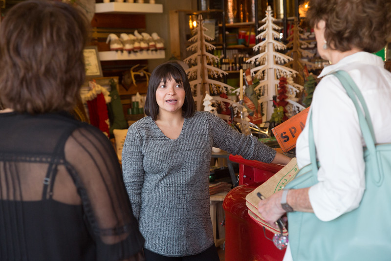 Brittany Matlock, co-owner of Plenty Mercantile, helps customers from out of town at 807 N Broadway in Oklahoma City.