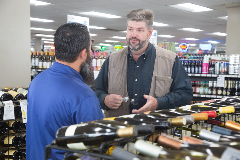 Greg Bynum, Assistant Special Agent In Charge with the ABLE commision, speaking to an employee at Byron's Liqour Warehouse in Oklahoma City.