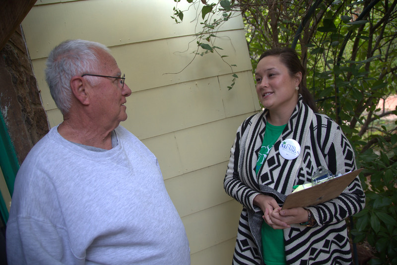 Oklahoma City resident Mike Ryan talks to State Repersenitive Cyndi Munson as she campaigns door to doir in her district.