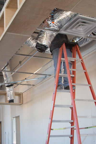 HVAC ducts being installed at Ellis Island Coffee and Wine Bar opening at 130 N Broadway in Oklahoma City, OK.