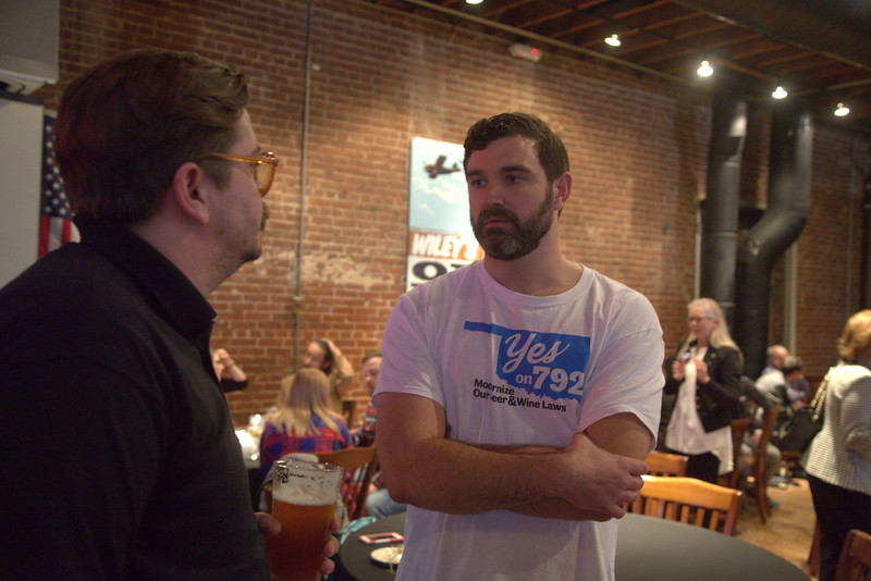 Jeff Caillouette talking with Alex Weintz at a watch party supporting State Question 792 at Bricktown Brewery in Oklahoma City.