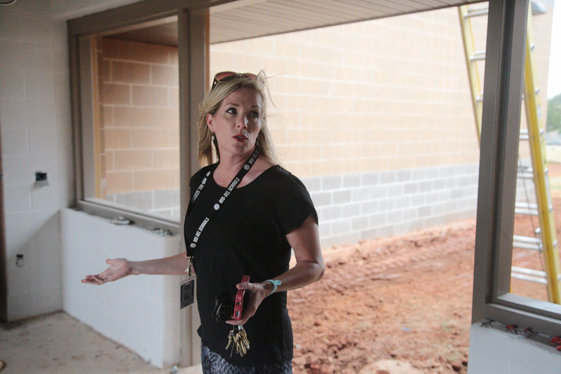 Principal Donna Collier walks through an unfinished classroom at Parkview Elementary. Like several other districts, Mid-Del used lease revenue bonds to finance construction, but critics have said lease revenue bonds are risky and might be unconstitutional.